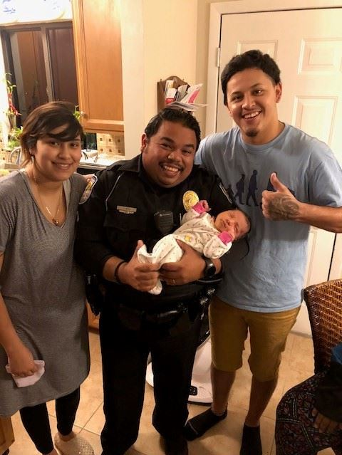 Pictured from left to right: Stephania Quivoga, Officer Jorge Goz, baby Alybree-Dejeus Cerda and Ale